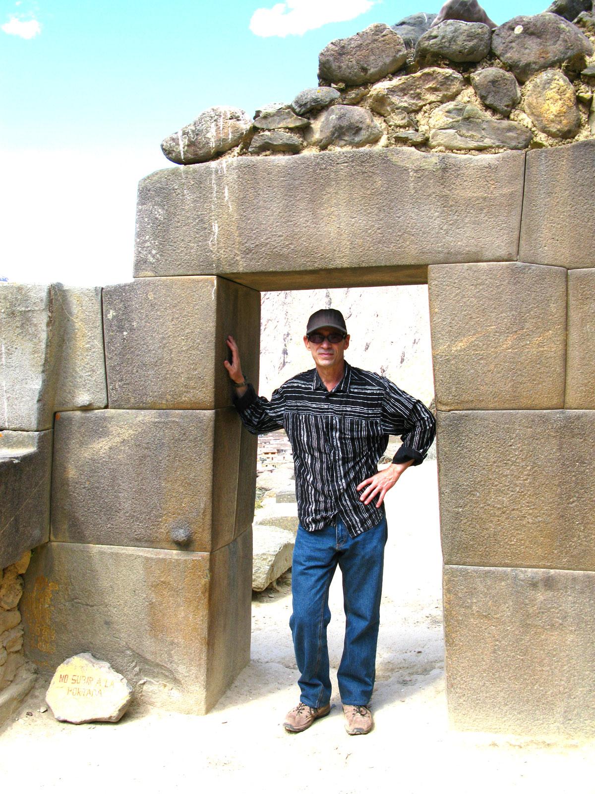 chuck jonkey standing in a trapezoidal door in Peru