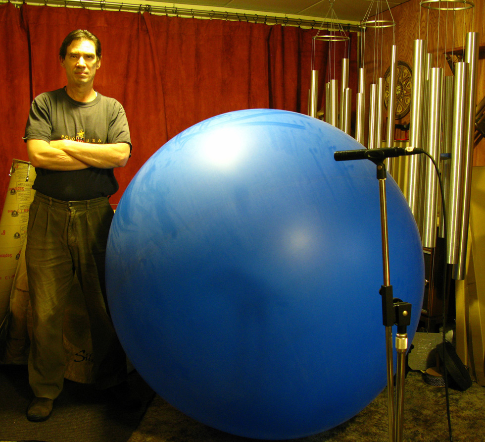Chuck Jonkey with giant balloon. Balloon Music