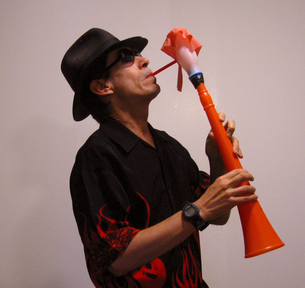 Chuck plays balloon sax