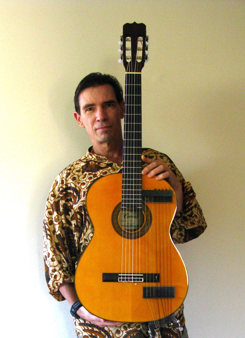 Chuck Jonkey with nylon string harp guitar